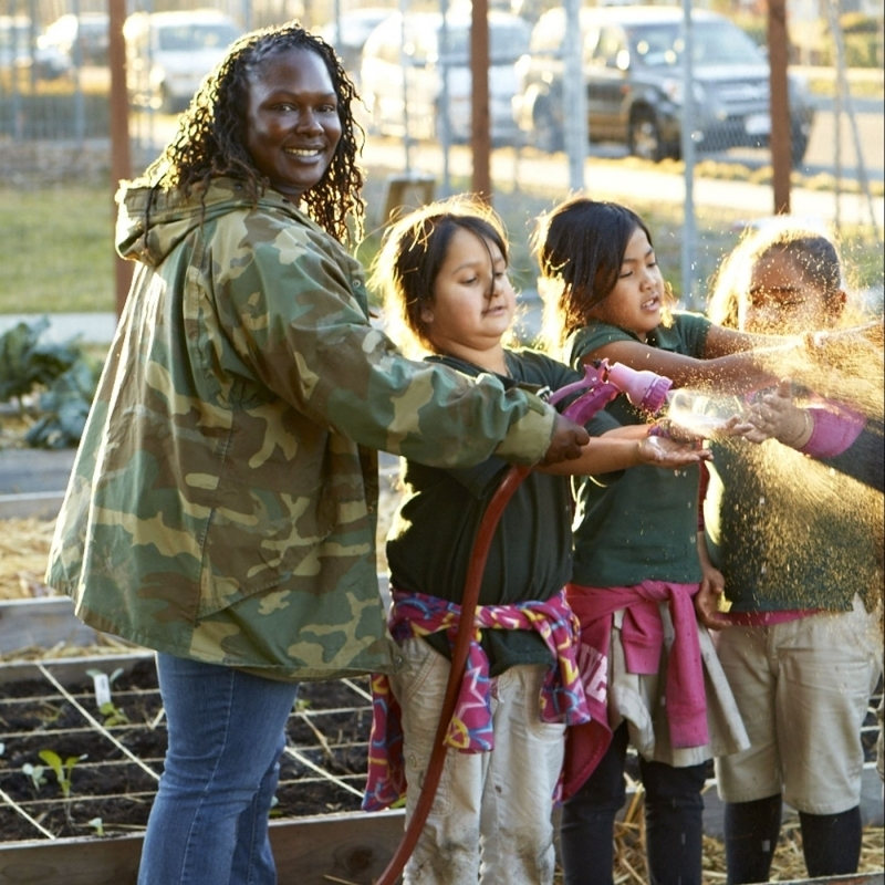 BOW0314A KELLY CARLISLE, Kelly D. Carlisle Founder, Executive Director, PHOTOGRAPHED AT ANV FARM 83RD AVE OAKLAND CA WITH LOCAL STUDENTS IN AFTERSCHOOL PROGRAM Acta Non Verba: Youth Urban Farm Project